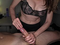 Busty masseuse jerking off her client's cock