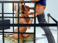 Abella Danger is sucking Xander's hard cock in the cage
