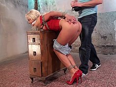 Long-haired blonde tied up and tortured with a vibrator